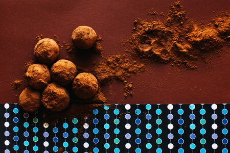Chocolate balls with cocoa powder spread over brown background Stok Fotoğraf