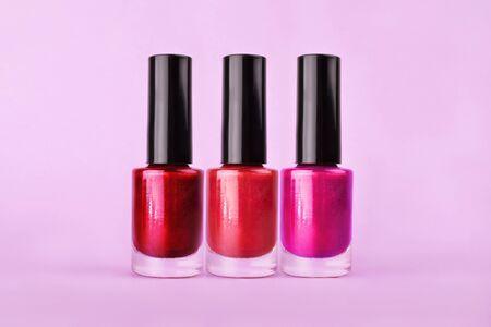 Set of three perfect bright sparkling nail polish bottles