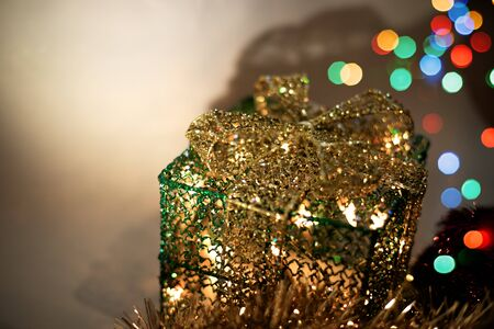 Sparkling gift box with colorful bokeh lights