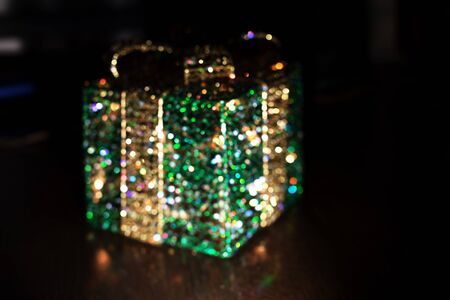 Defocused sparkling gift box with bright colorful lights