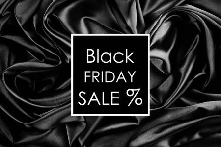 Black friday sale text on black wavy textile background, banner Stok Fotoğraf