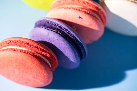 Colorful cakes macaroon or macaron on blue background, close up Stok Fotoğraf