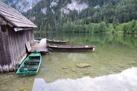 mountin: House and boats on lake