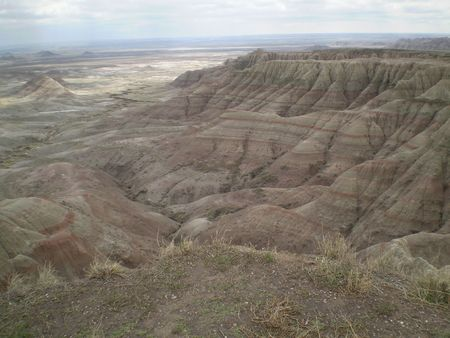 Looking down at a valley in the South Dakota Badlands from a high flat.