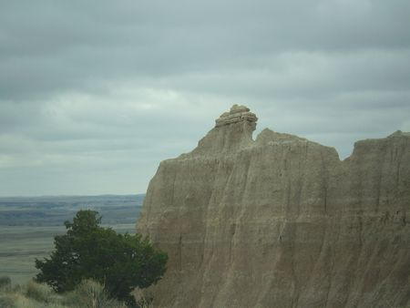 Sediment layers of a high rock formation in the Badlands of South Dakota Stock Photo