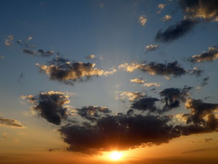 A beautiful sunset with rays of light fanning out from behind the clouds. Stock Photo - 4829367