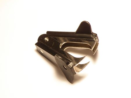 Image of a black staple remover laying on its side. Soft shadows on a white background. corporate Stock Photo