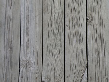 Deck boards faded from the weather and sun. Aged pine boards. Stock Photo