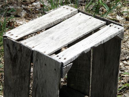 An image of an old apple crate. The wood has been faded over the years to a dull grey. Stock Photo