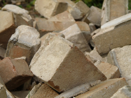 fire bricks: A pile of old fire bricks. Construction and demolition. Brick and mortar.