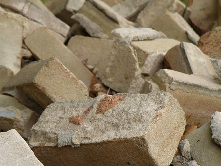 A pile of old fire bricks. Construction and demolition. Brick and mortar.