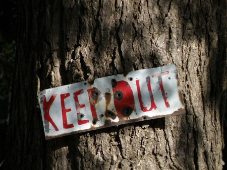 Keep out sign with creepy dark shadows. Halloween style sign with scary type. Bullet holes.