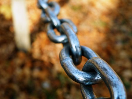 Silver links of a stretched chain. Stock Photo - 5955080