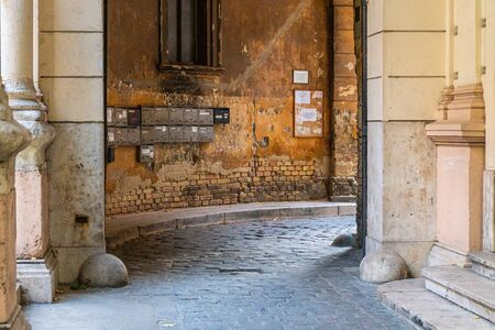 Old letter boxes against a wall in ancient city street. Antique architecture