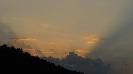 Sun setting behind mountain