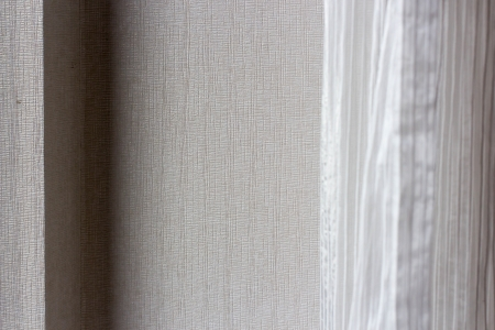 A Warm wall with a white curtain Stock Photo