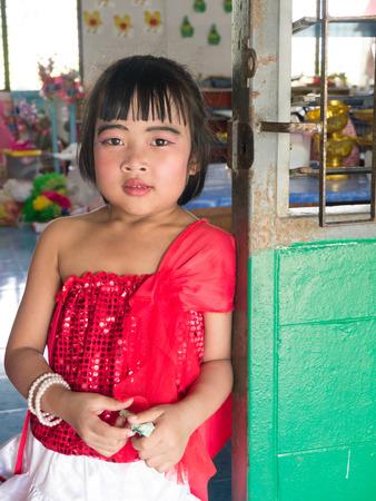 CHONBURI, THAILAND - March 29, 2014 - Portrait of Thai elementary girls in red dress   Editorial