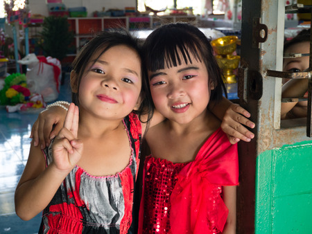 CHONBURI, THAILAND - March 29, 2014 - A couple of Thai elementary girls in red dress