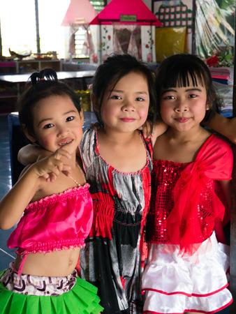 CHONBURI, THAILAND - March 29, 2014 - Three Thai elementary girls in red dress   Editorial
