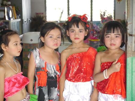 CHONBURI, THAILAND - March 29, 2014 - Four Thai elementary girls in red dress   Editorial