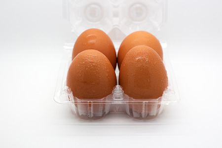 Four eggs in open transparent package