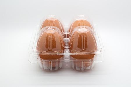Four eggs in closed transparent plastic package