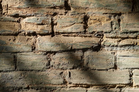 urban art: Vintage street brick background. Weathered texture of stainted old brik wall. Grunge rusty blocks. Urban wallpaper. Nature artistic texture. Urban art.