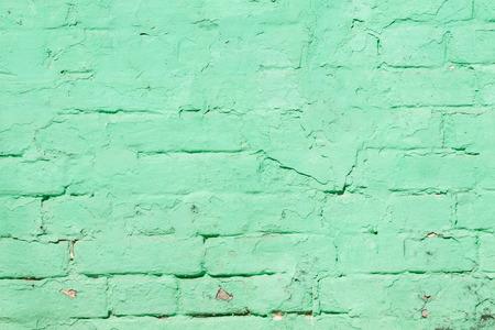 celadon: Vintage street brick background. Weathered texture of stainted old brik wall. Grunge rusty blocks. Urban wallpaper. Nature artistic texture. Urban art.