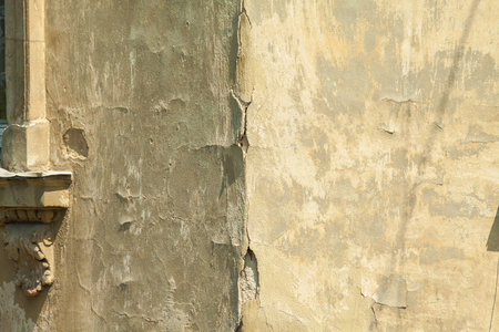 stucco facade: old grunge vintage stucco. Facade decoration elements. Old house. Close-up elements Stock Photo