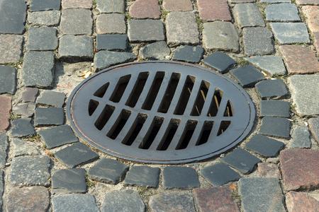 grating: drainage grating. street paving stone. Stock Photo