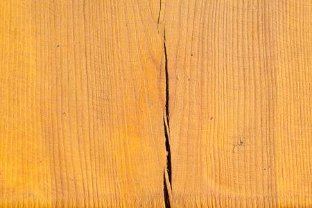 lacquered: lacquered wood with a crack