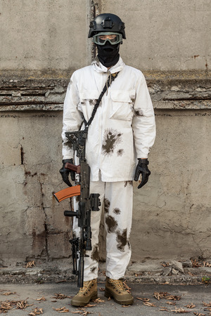 ak47: a soldier in the winter camouflage suit armed with AK-47 Stock Photo