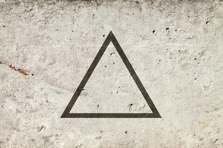 third eye: Black flat triangle on abstract stone background. Abstract psychedelic background. Stock Photo