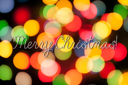 cozy: Merry Christmas congratulation on cozy festive bokeh background