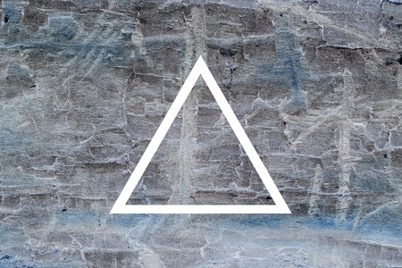 psychedelic background: White flat triangle on abstract stone background. Abstract psychedelic background. Stock Photo