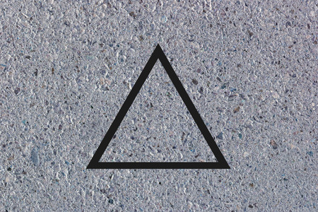 concrete background: Black flat triangle on abstract concrete background. Abstract psychedelic background.