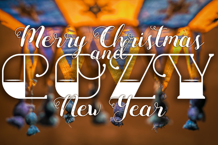 cozy: Merry Christmas and Cozy New Year congratulation on cozy festive background