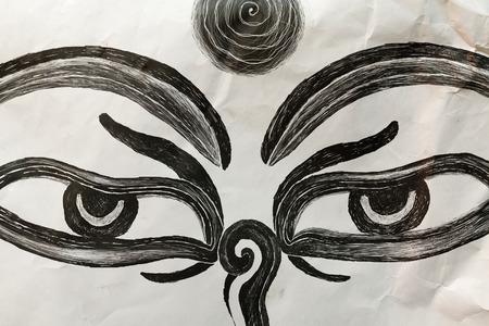 nonviolence: Hand drawn Eyes of Buddha on mauled paper