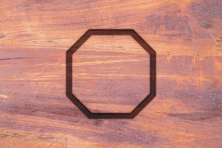 Flat octagon on abstract grunge metal texture Stock Photo