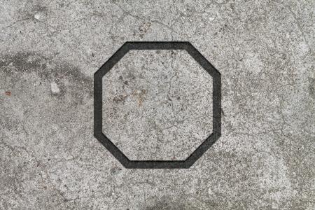 octagon: Flat octagon on concrete background Stock Photo