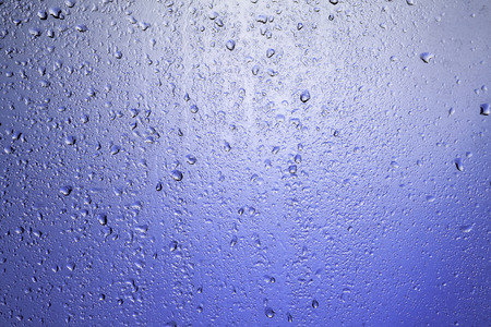 thirst quenching: Rainy window. Drops on the glass.