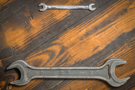 argentum: Big and small. Two wrenches on wooden background. Stock Photo