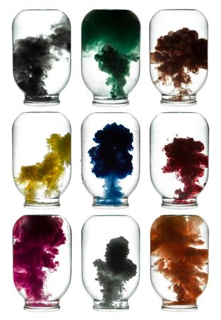 swirling: Paint swirling in water. Colorful smoke a glass jar.