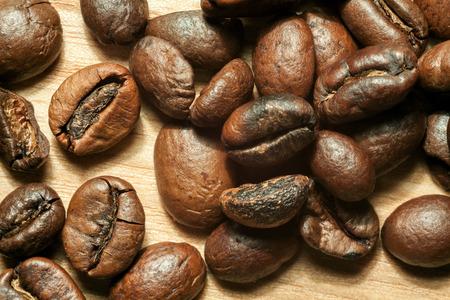 beech tree beech: Coffee beans on beech tree background close-up