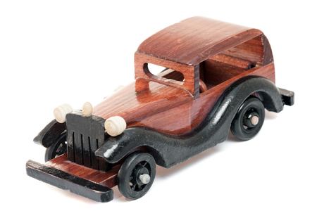 pedagogy: Vintage wooden toy car isolated from background