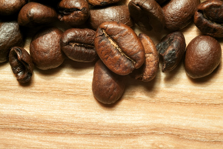 beech tree: Coffee beans on beech tree background close-up