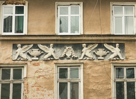 stucco facade: Facade with decorative stucco. Lviv, Ukraine. European travel photo.