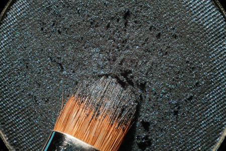 crumbly: Macro crumbly eyeshadow refill. Professional cosmetic. Makeup tools. Stock Photo