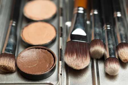 defects: Professional cosmetic. Cream concealer. Working with skin defects. Stock Photo