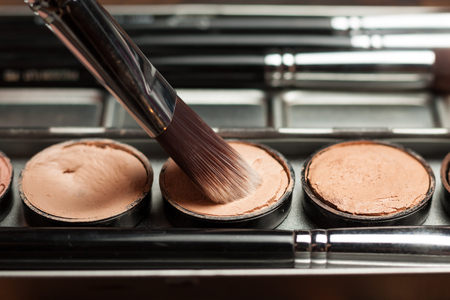 Professional cosmetic. Cream concealer. Working with skin defects. Stock Photo